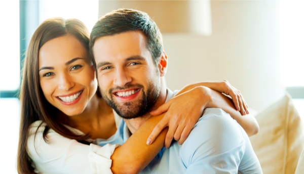 photo of man and woman smiling