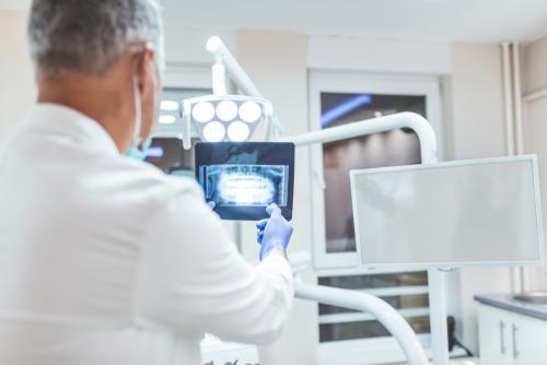 dentist analyzes x-ray